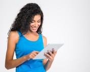Portrait of a smiling woman using tablet computer